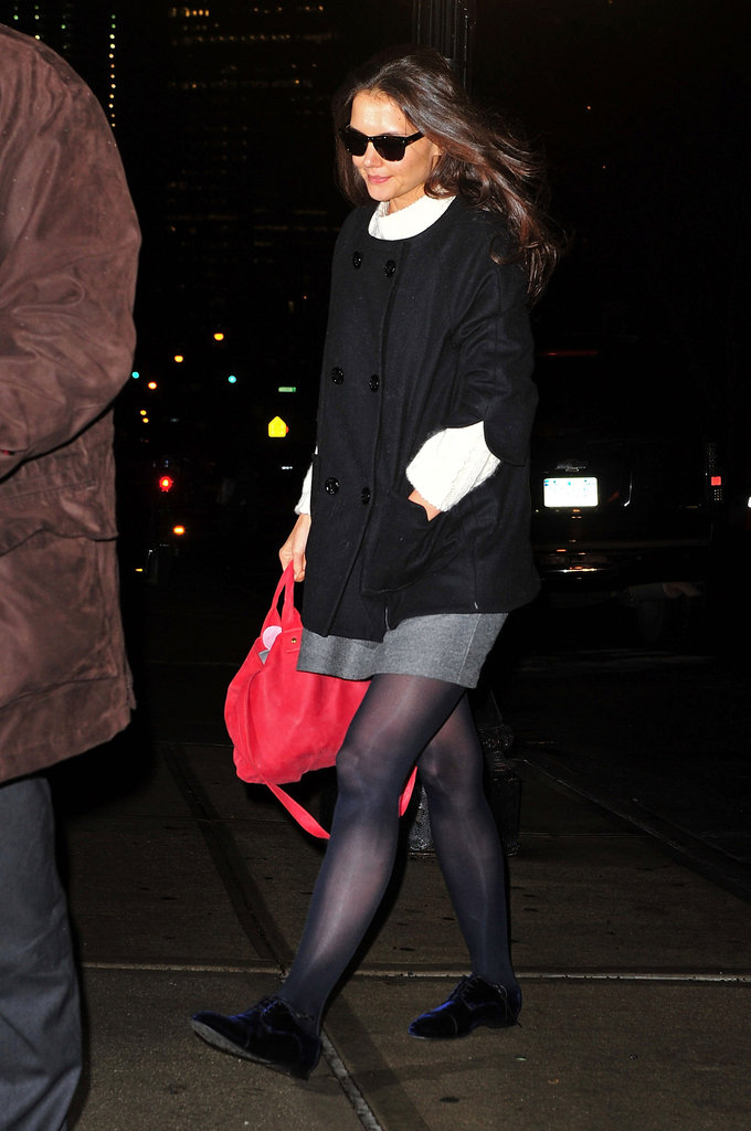 Katie Holmes carried her favorite red bag to her helicopter.