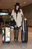 Rachel Bilson juggled her luggage after landing.