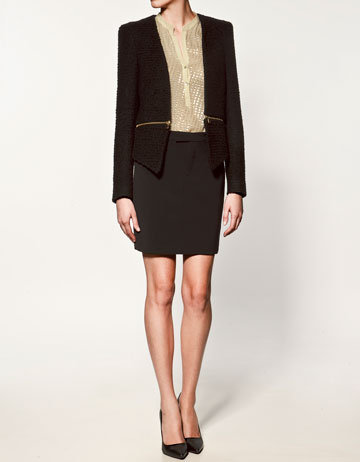We love this ultra-chic, perfect for topping off a little red dress. Zara Jacket With Zips at Waist ($129)