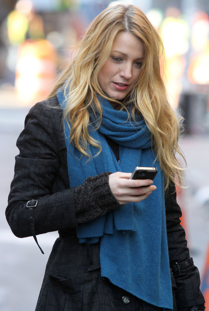 Blake Lively checks her iPhone messages.