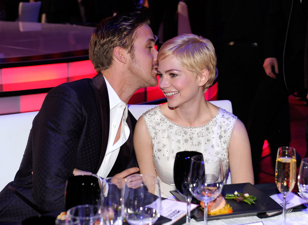 Ryan whispers something in Michelle Williams's ear as they attend the Critics' Choice Movie Awards.