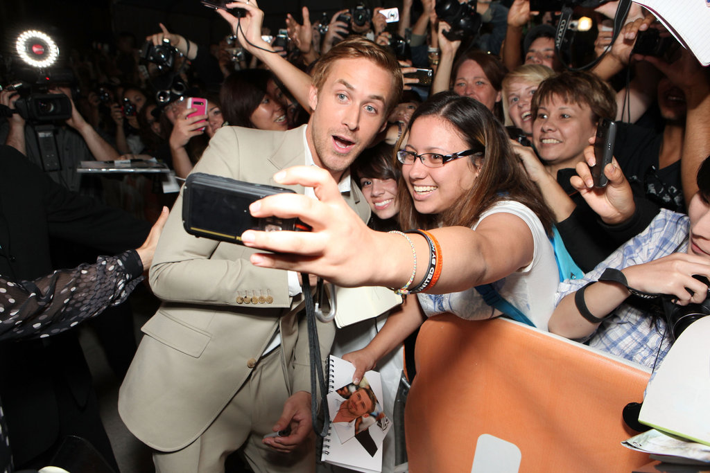 A lucky fan snaps a pic with Ryan Gosling at the premiere of The Ides of March at the Toronto Film Festival.