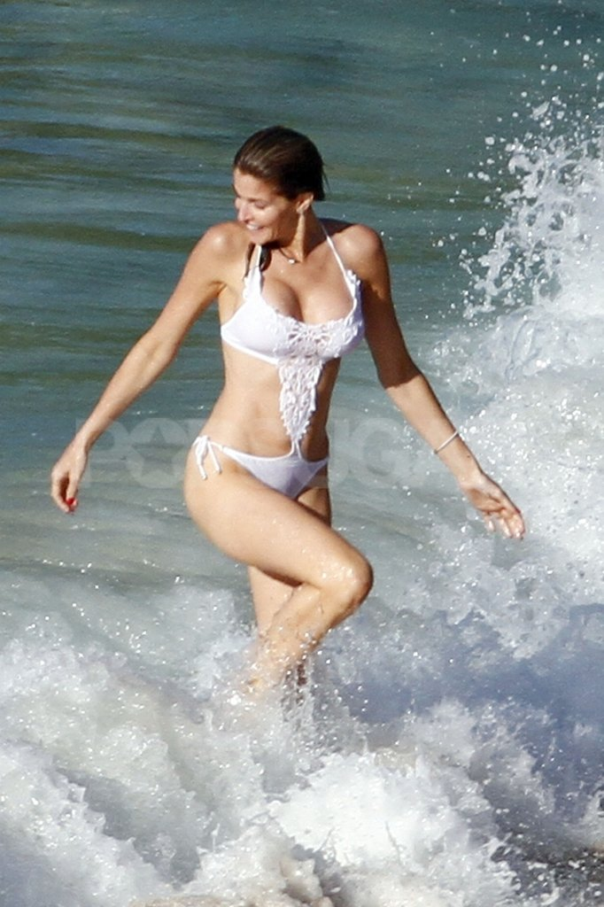 Stephanie Seymour ran through the ocean in a white bikini.