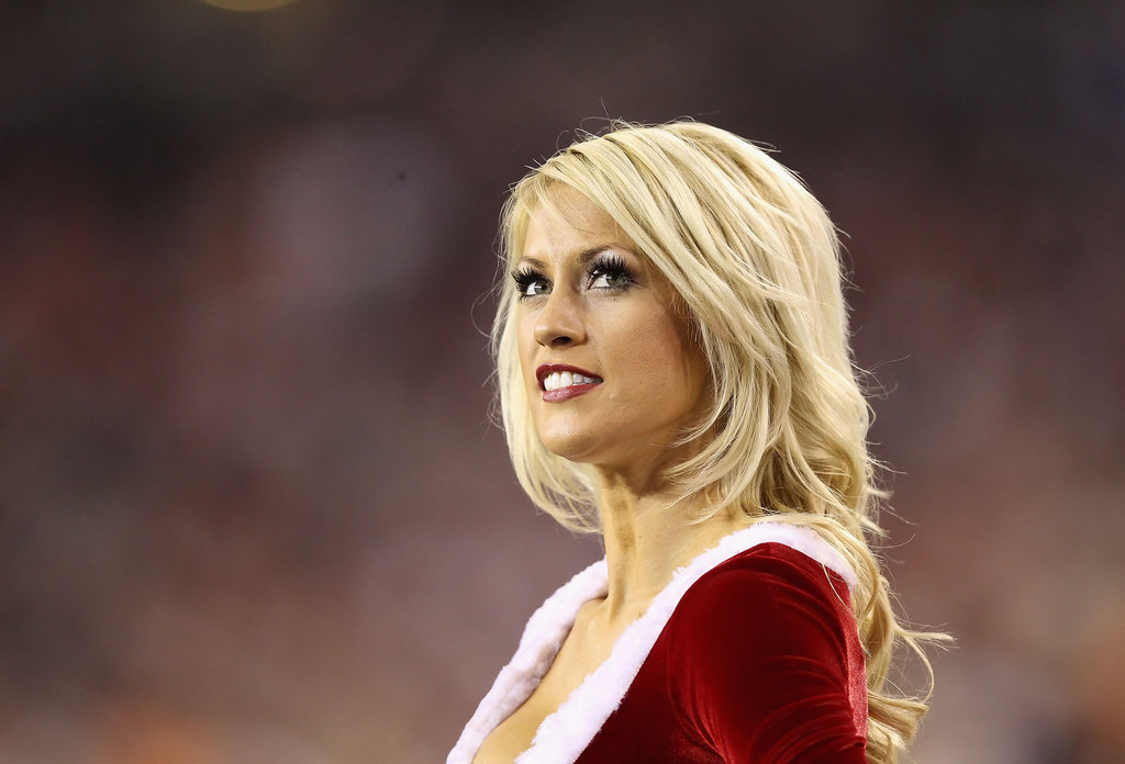 An Arizona Cardinals cheerleader takes in the game.