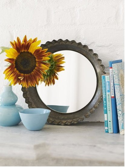 Turn vintage pie tins into a charming mirror. Source: Sweet Paul
