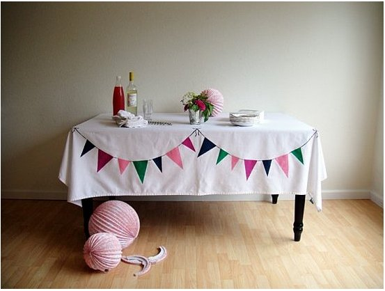 A DIY bunting tablecloth is not only an absolutely adorable idea, but also a fun staple to reuse again and again whenever you have something to celebrate. Source: The Sweetest Occasion