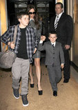 Victoria Beckham left the Claridge's Hotel in London with Brooklyn and Cruz.
