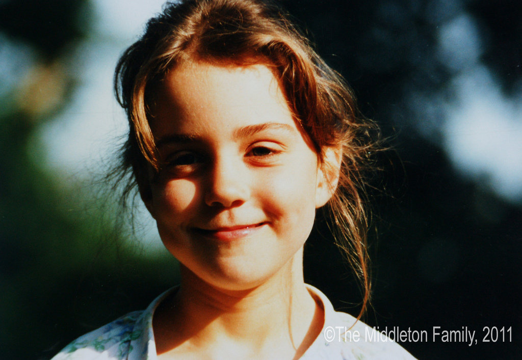 At five years old, cute Kate Middleton smiled on a Summer afternoon in the UK.   © The Middleton Family, 2011. All rights reserved.