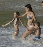 Rhea Durham in a bikini with her kids.