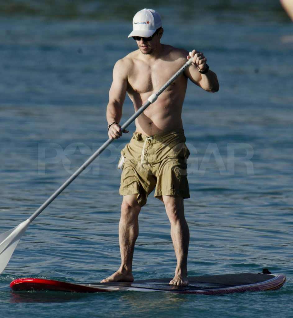 Mark Wahlberg paddle boarding shirtless.