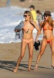 LeAnn Rimes and a friend donned skimpy bikinis for a walk on the beach in Maui in January 2012.