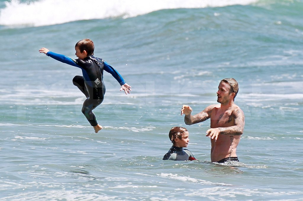 David Beckham played with his sons Romeo and Cruz at the beach in LA during August 2011.