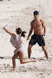 Olivia Palermo playing paddleball with boyfriend Johannes Huebl.
