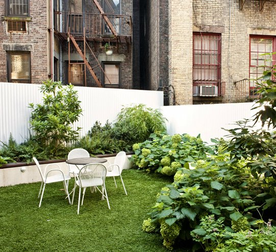 A lush garden is a major luxury in a crowded urban space like the West Village. See more photos of this lovely little pocket garden at Foras Studio.