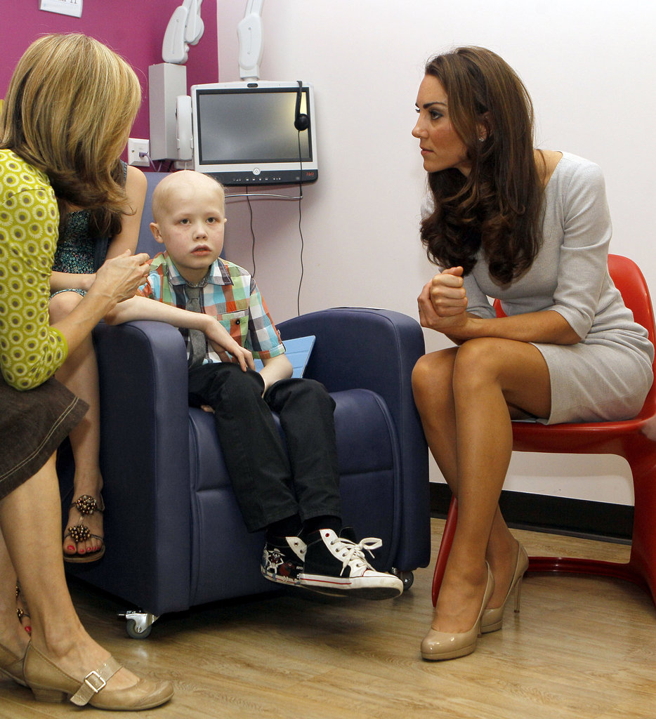 Kate spends a moment with a young cancer patient during her royal visit to the opening of the new Oak Center For Children and Young People at the Royal Marsden Hospital.