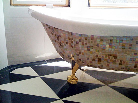 Add a little Versace to your bathroom with a mosaic tub project.