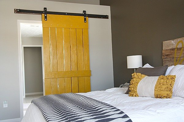 This sliding barn door  in bright yellow, created by House*Tweaking is so brilliant! I might have to try it at my home, too. Source: House*Tweaking