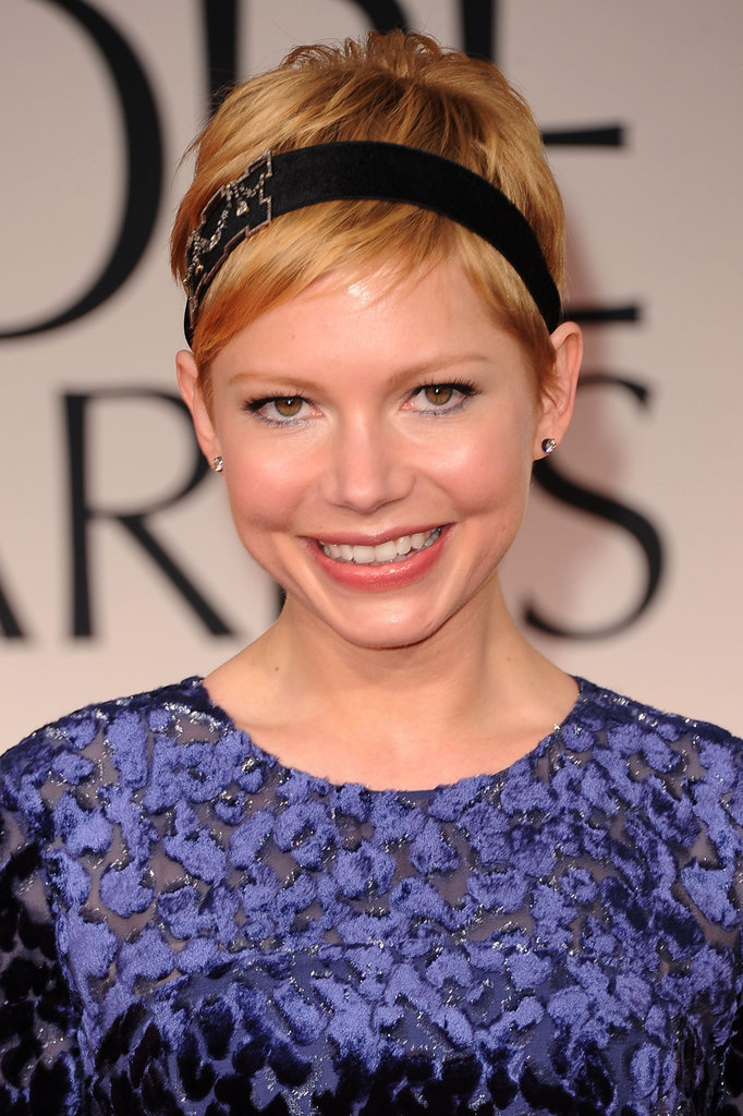 Michelle Williams smiled at the 2012 Golden Globe Awards.