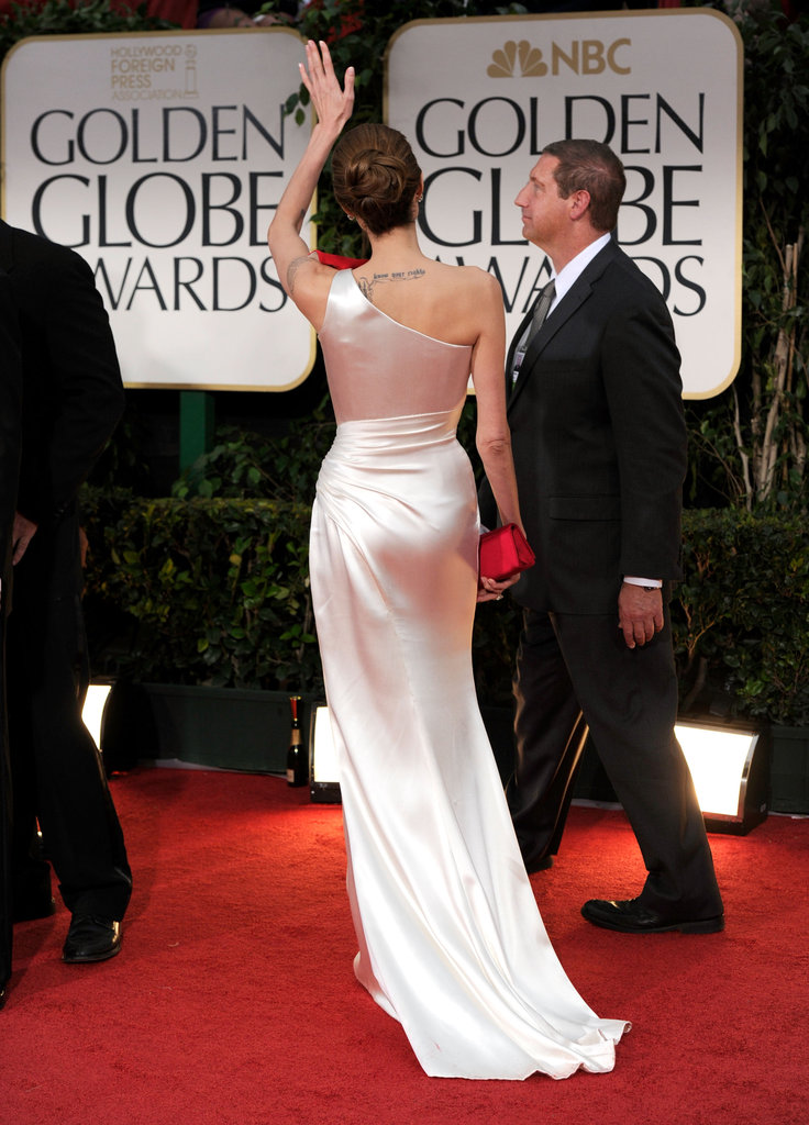 Angelina Jolie showed the back of her one-shoulder Versace dress.