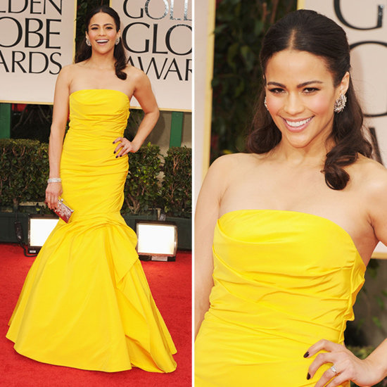Paula Patton may just be the sunniest lady at the Golden Globes. The actress is wearing a gorgeous, bright yellow strapless Monique Lhuillier gown with a sleek fishtail hem, and she finished the look with Kwiat jewelry and a Judith Leiber clutch.