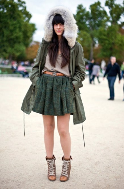 An oversized fur hood and a flouncy skirt lend glamour. Shop the look:  Photo by Phil Oh
