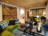This large barn door serves as a grandiose entrance to the living room of HGTV's 2011 Dream Home.  Source