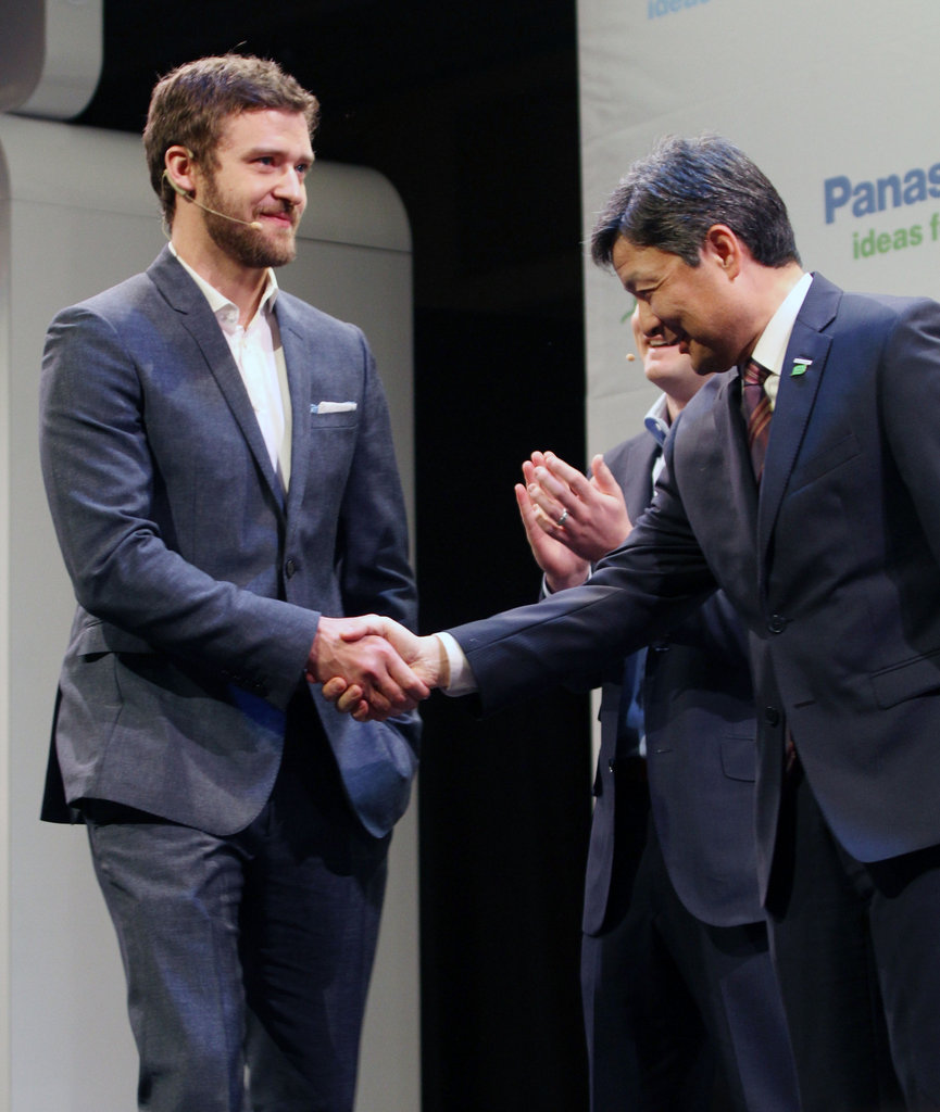 Justin Timberlake shook hands with Panasonic's Shiro Kitajima.