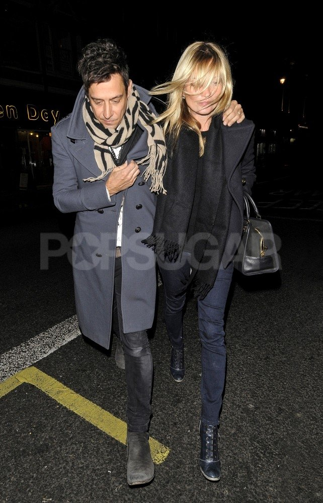 Kate Moss and Jamie Hince stuck together on a windy night in London.