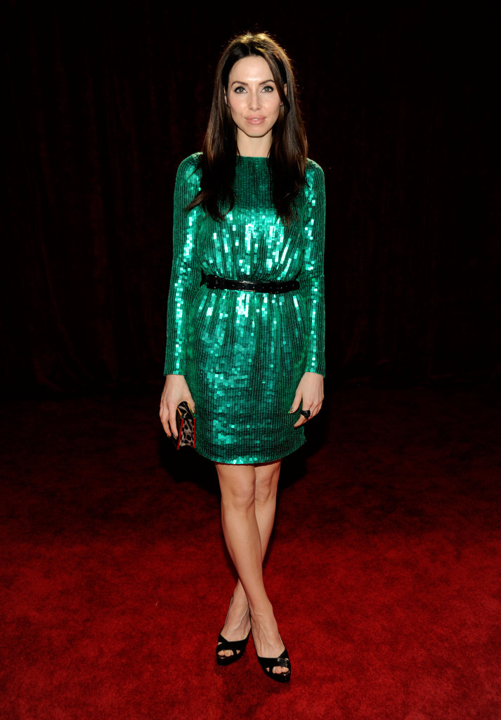 Whitney Cummings in a green dress at the People's Choice Awards.