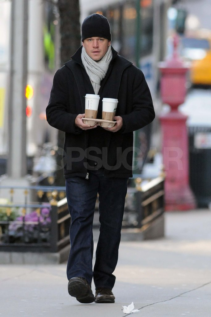 Matt Damon carrying Starbucks.