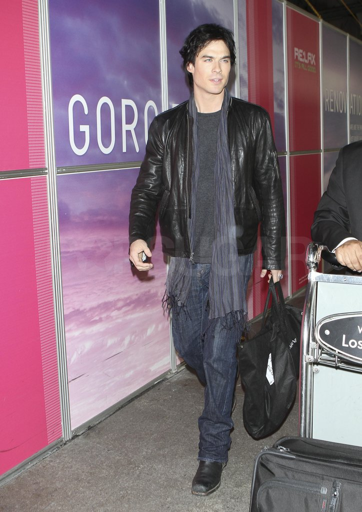 Ian Somerhalder traveled in a black leather jacket.