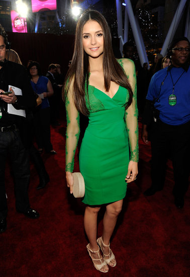 Nina Dobrev wore a bright green Elie Saab dress.