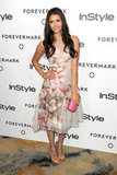 Nina Dobrev channeled feminine glamour in a floral-print tea-length dress.