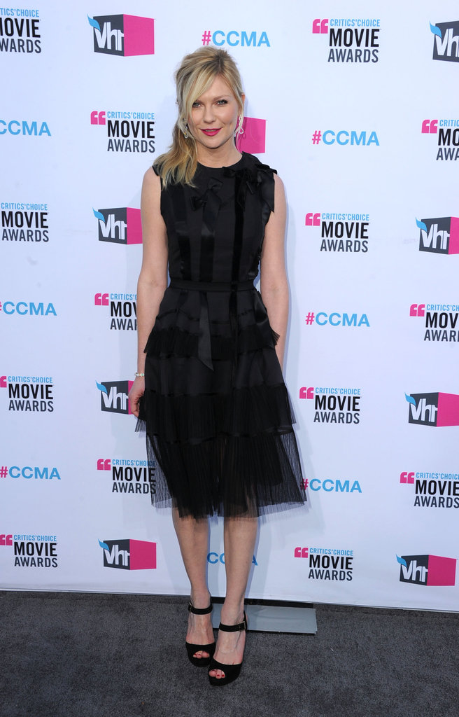 Kirsten Dunst in a black tulle Christian Dior dress.