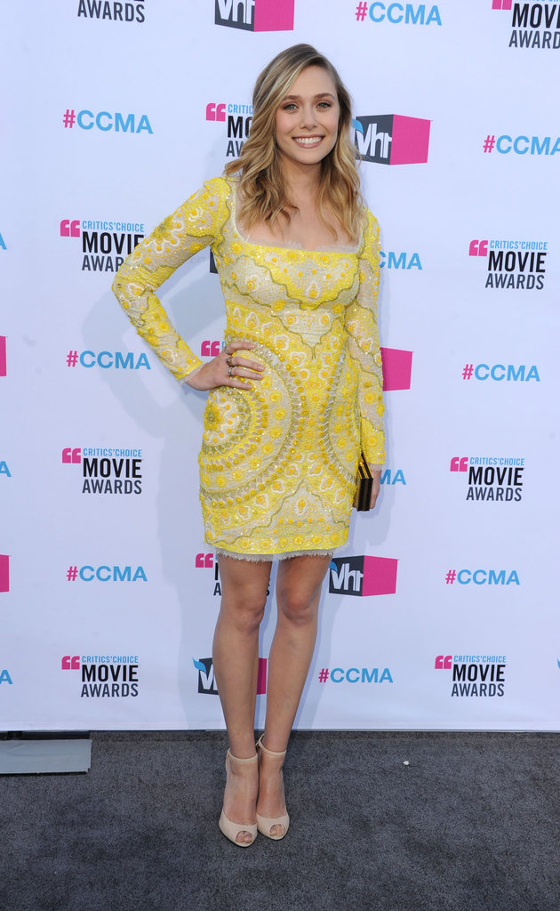 Elizabeth Olsen was in a yellow Emilio Pucci number.