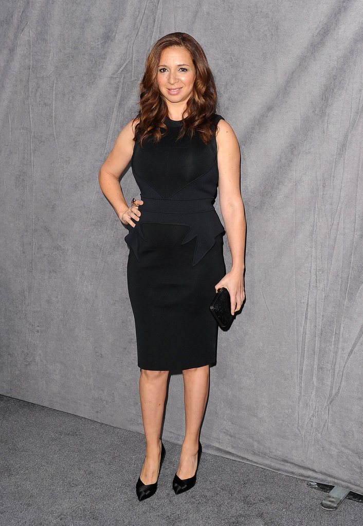 Maya Rudolph in a black sheath dress.