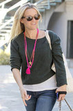 Reese Witherspoon wore a bright pink necklace and gray sweater in LA.