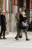 Mary-Kate and Ashley Olsen left their Manhattan offices.