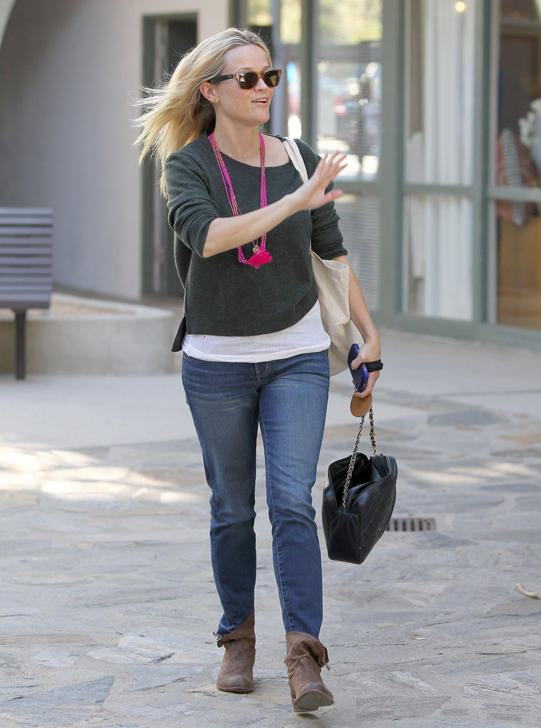 Reese Witherspoon waved goodbye to friends on her way home from her office.