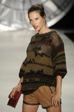 Alessandra Ambrosio hid her baby bump under a sweater.