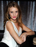 Rosie Huntington-Whiteley sat at a table at the Weinstein Company's Golden Globes after party.