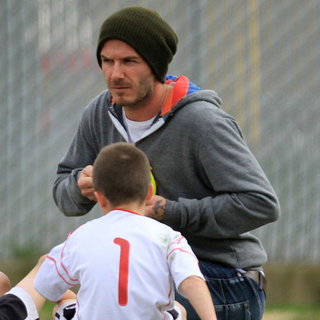 David Beckham Playing Soccer With Romeo & Cruz Pictures