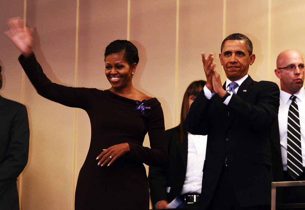 The Obamas wave to the audience at the Kennedy Center.