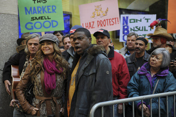 "Tracy and Richards join ardent protesters in the trenches. That ""This Marker Smell Good"" sign is the kicker in this photo.  Photo courtesy of NBC"