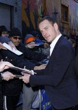 Michael Fassbender signed autographs for fans.