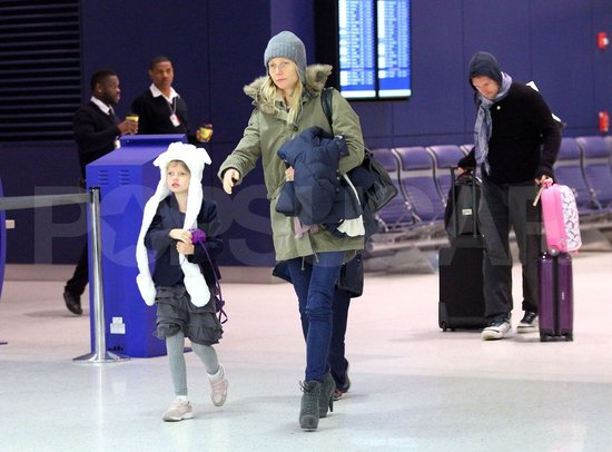 Gwyneth Paltrow Takes Off With Chris, Apple, and Moses