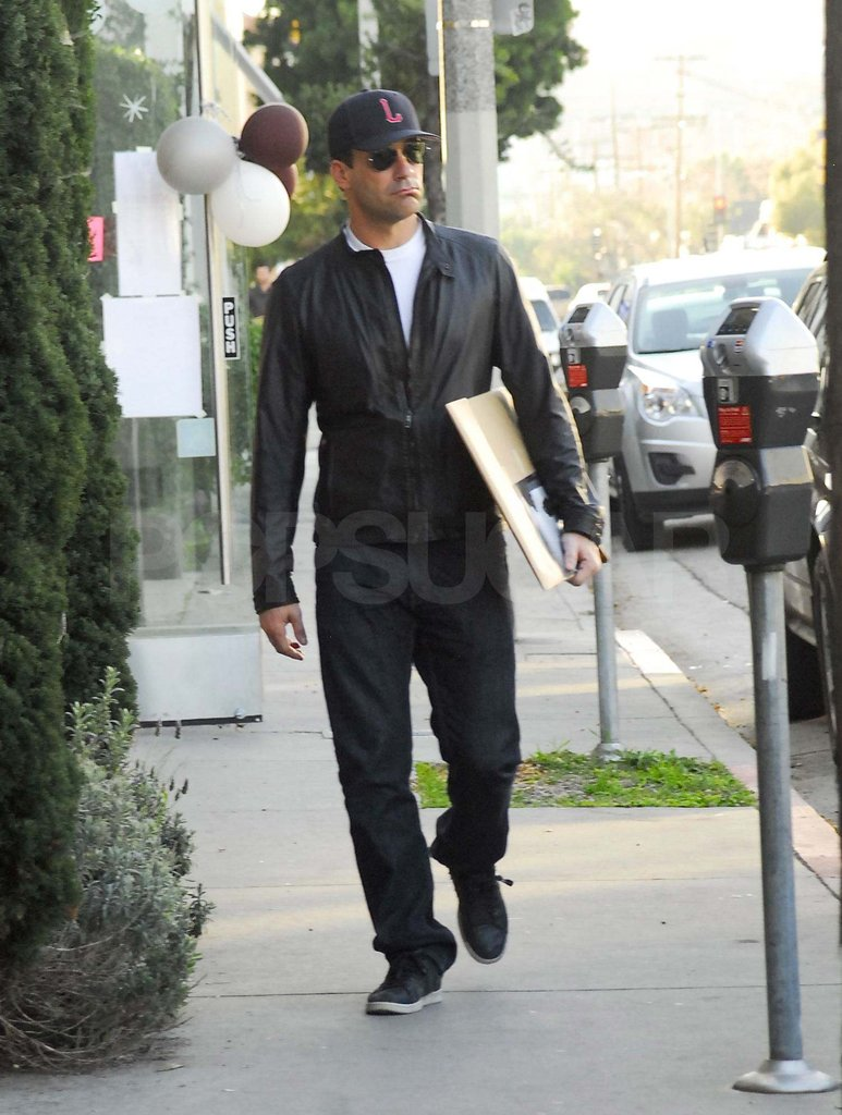 Jon stepped out in casual sneakers and a black leather jacket.