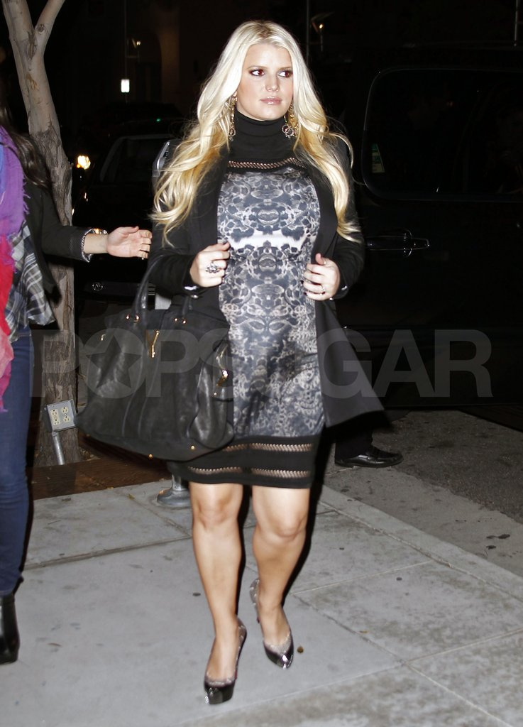 Pregnant Jessica Simpson in a black lace dress.