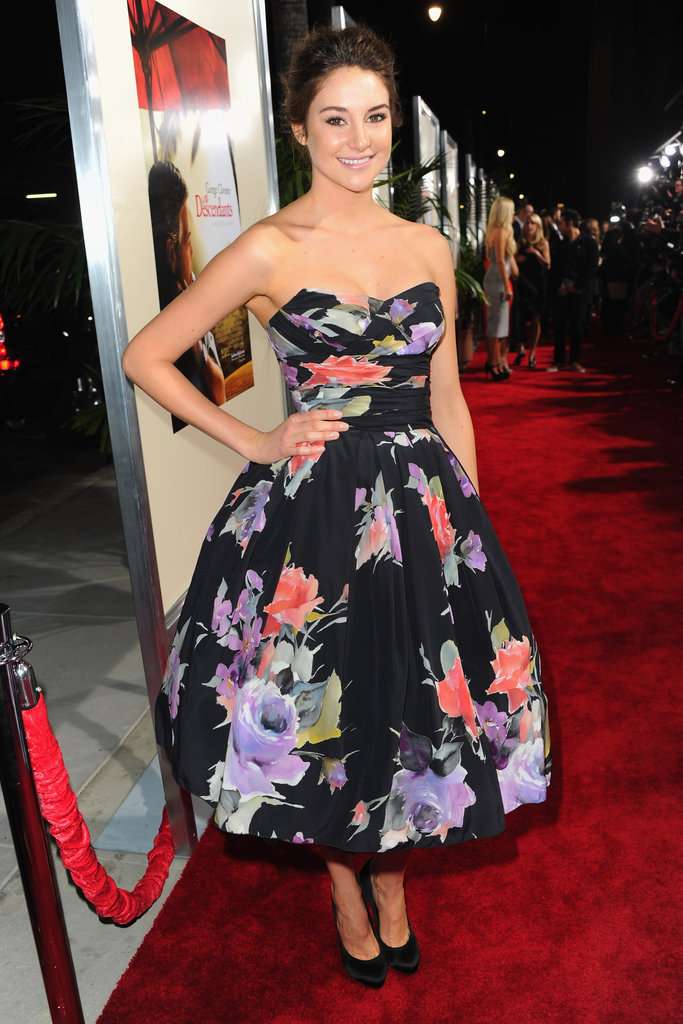 For the 2011 red carpet premiere of The Descendants, Shailene chose an ultrafeminine black floral tea dress by Dolce & Gabbana. Her full-skirt frock was teamed with Rachel Zoe Collection pumps.
