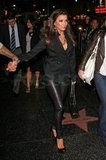 Eva wore black leather leggings for their date night.